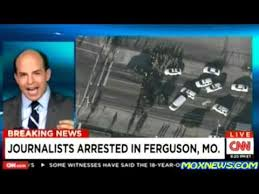 CNN report after journalists were arrested in Ferguson, Mo.