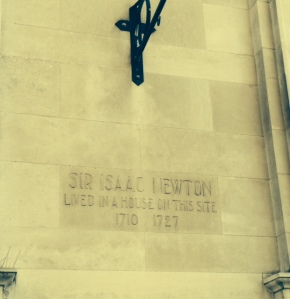 Historic marker to Sir Isaac Newton on library in Leicester Square, London.