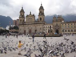 A young boy feeds pigeons at one of the main squares in Bogota.