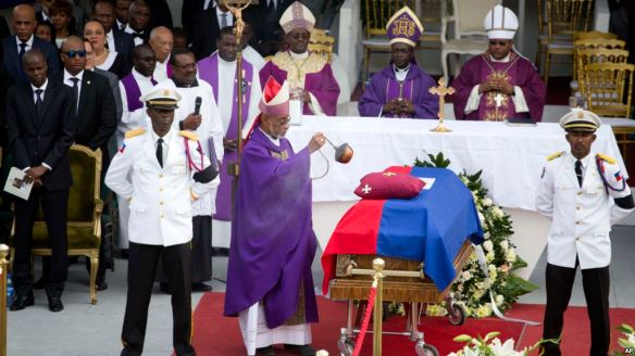 Preval laid to rest